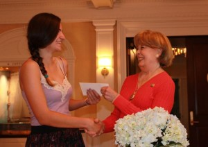 2013 Scholarship Winner Kiara Kalloway receives her check from SPGC President, Jo Benson